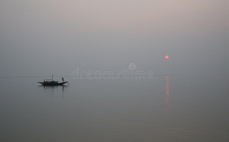 Zonsondergang, de delta van Ganges stock afbeelding