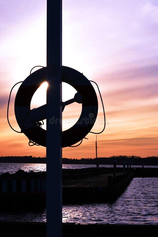 Zonsondergang in Deense haven stock afbeelding