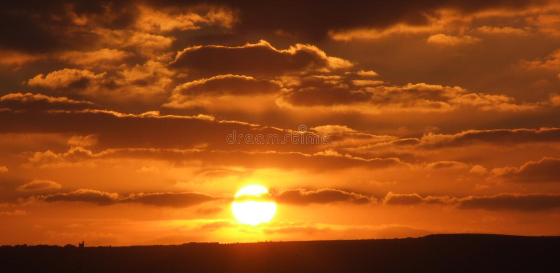Zonsondergang door overzees stock foto's