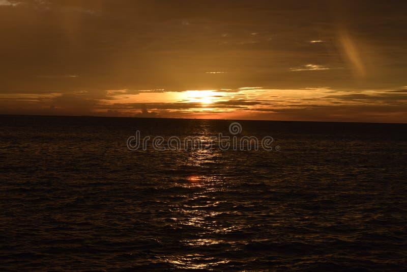 Zonsondergang eerst in Taplau stock afbeeldingen