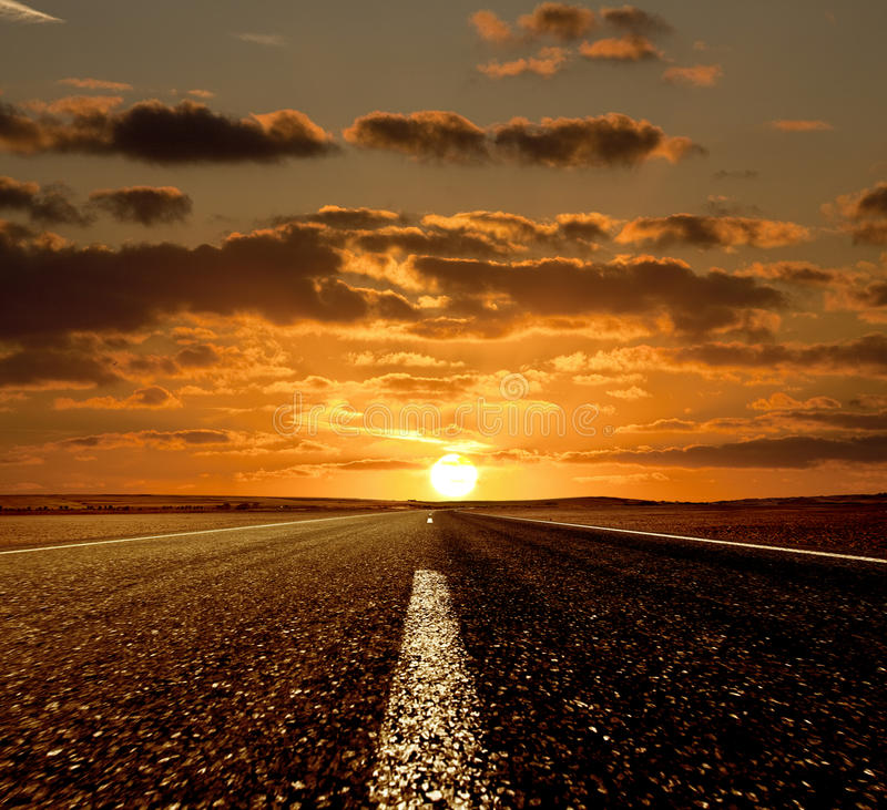 Zonsondergang en de Weg royalty-vrije stock fotografie