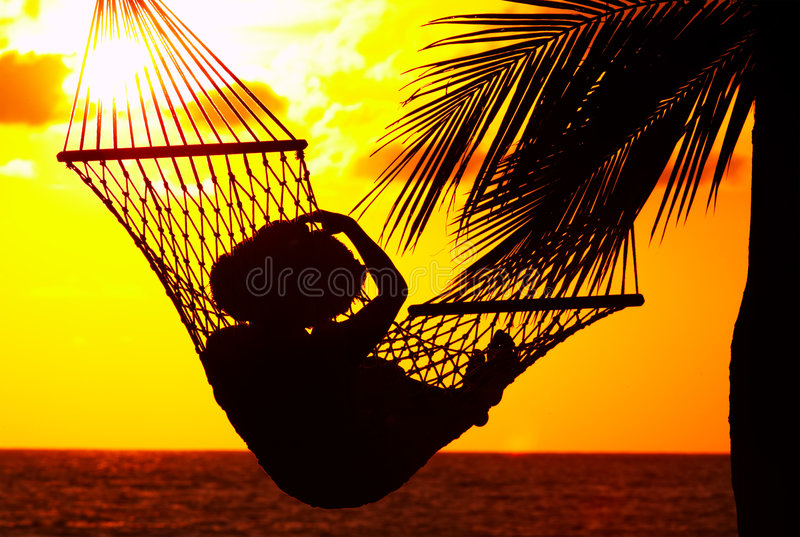 Zonsondergang en hangmat royalty-vrije stock foto's
