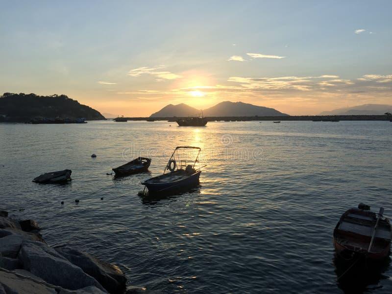 Zonsondergang en het Overzees stock afbeelding