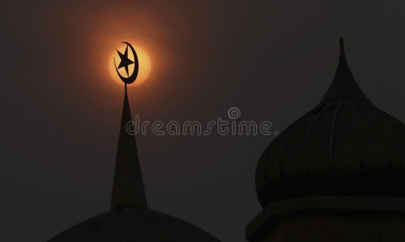 Zonsondergang en moskee stock foto