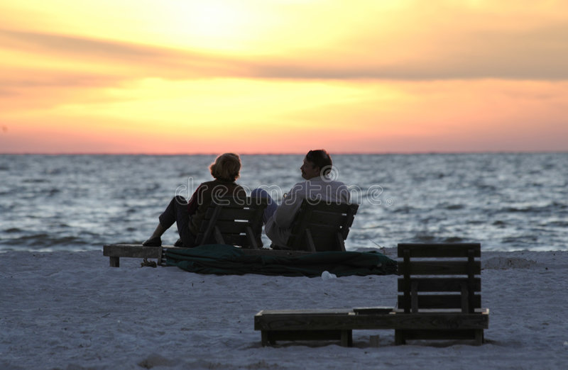 Zonsondergang en pensionering stock foto