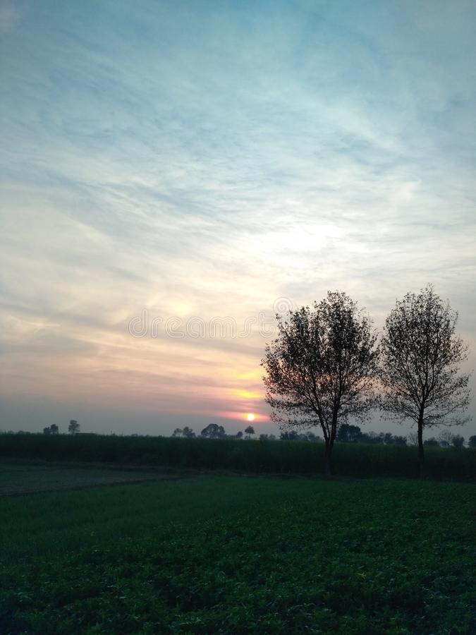 Zonsondergang en sunries stock afbeeldingen