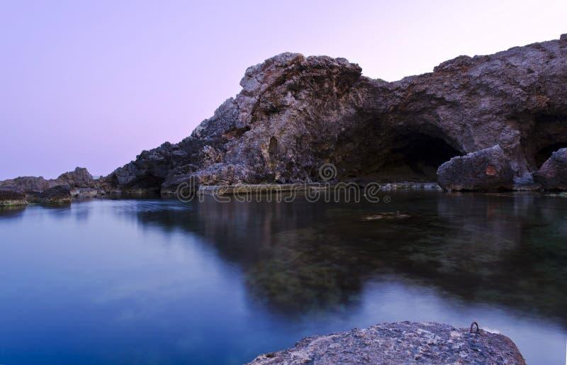 Zonsondergang in Ghar Lapsi - Malta stock afbeelding