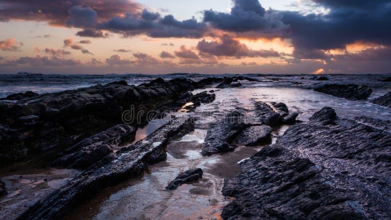 Zonsondergang in het overzees van Figueira stock afbeeldingen