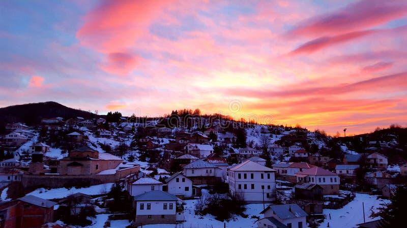 Zonsondergang in mijn dorp stock foto's