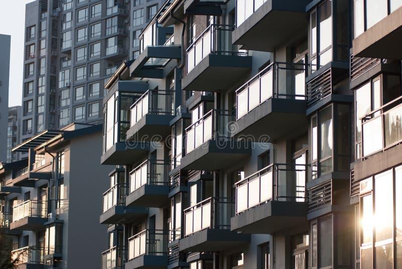Zonsondergang Onroerende goederen China - Uitvoerende flats stock afbeeldingen