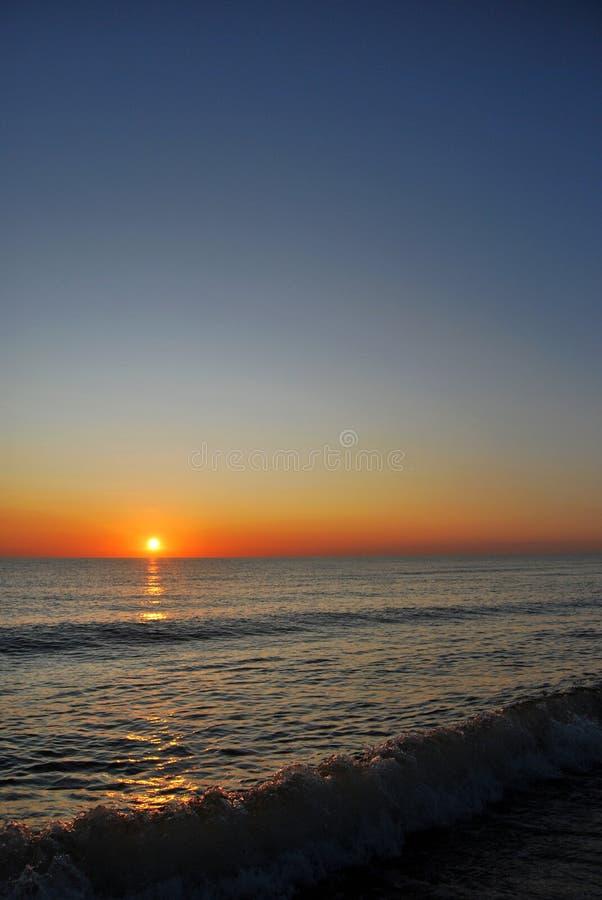 Zonsondergang op het overzees stock afbeeldingen