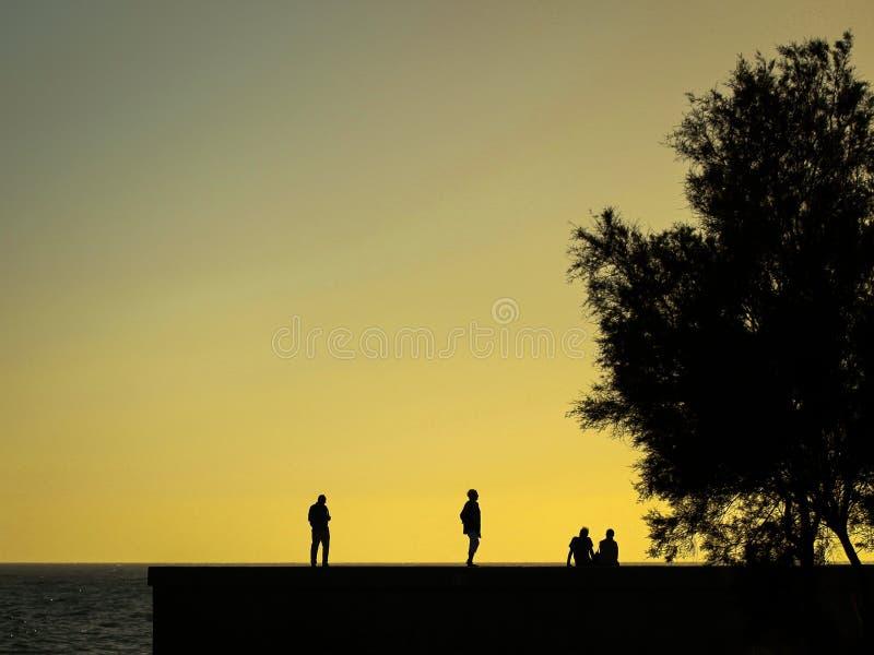 Zonsondergang op pijler stock afbeeldingen