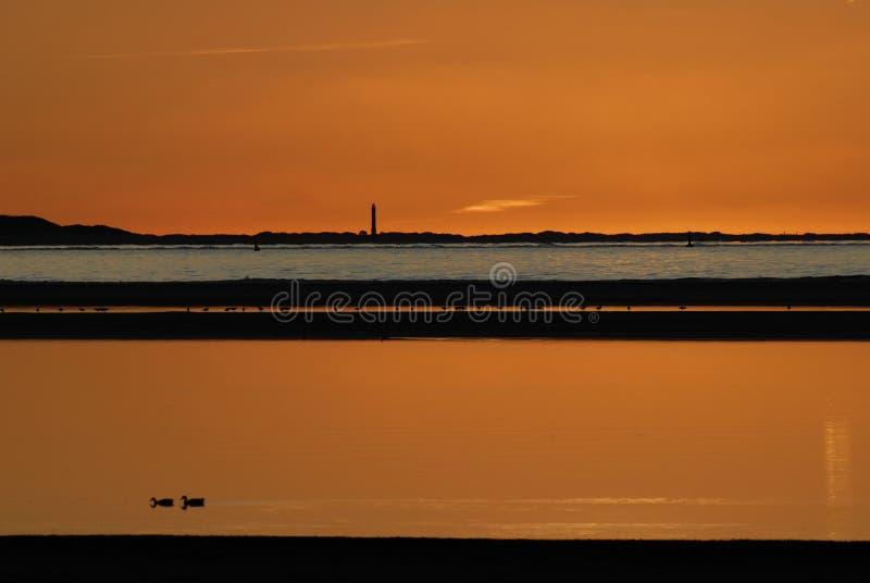 Zonsondergang over Baltrum stock foto