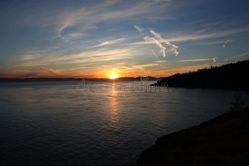 Zonsondergang over Haro Strait stock foto