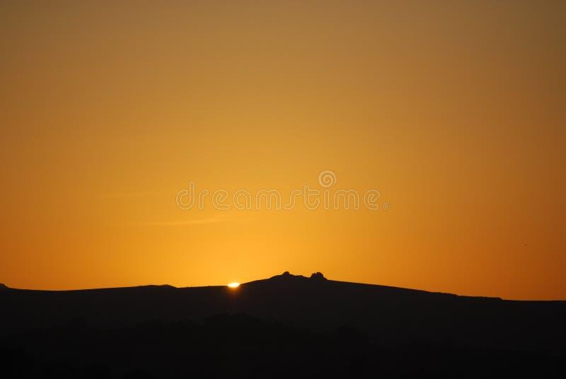 Zonsondergang over haytor stock fotografie