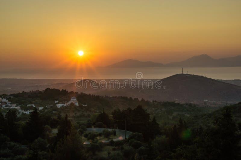 Zonsondergang over het eiland/Zia van Kos stock fotografie
