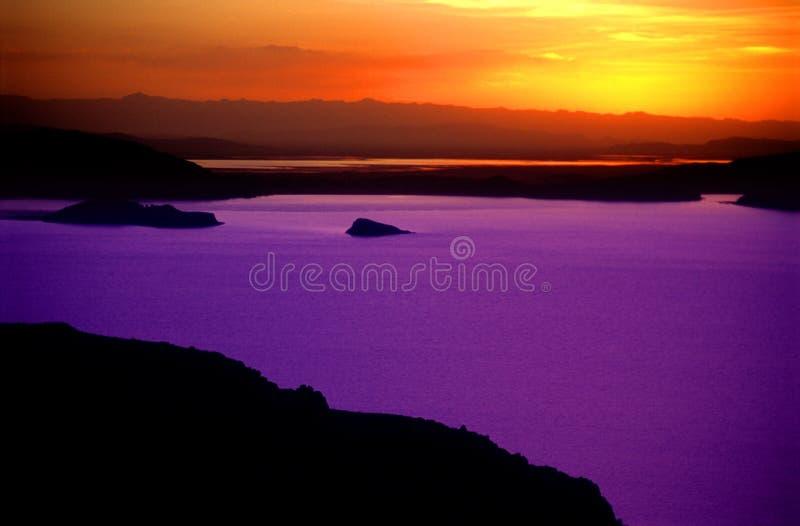 Zonsondergang over Meer Titicaca Peru - 3 stock foto