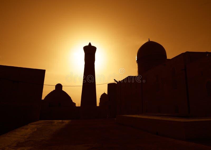 Zonsondergang over oude stad van Boukhara stock foto's