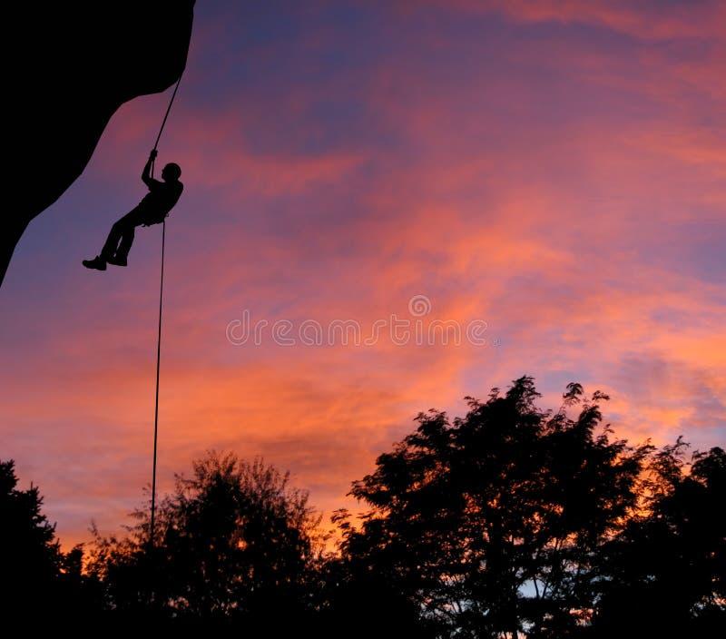 Zonsondergang Rappel stock afbeelding