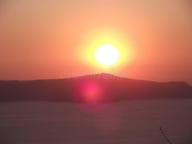 Zonsondergang in Santorini, Oia Dorp stock fotografie