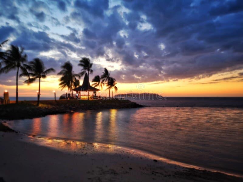 Zonsondergang in Strand stock afbeeldingen