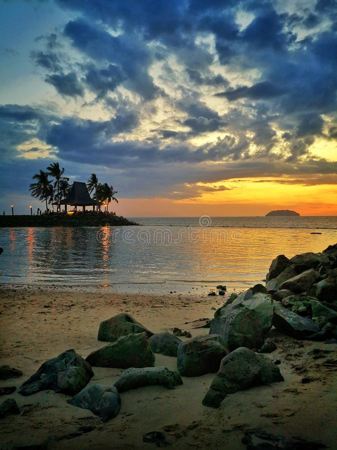 Zonsondergang in Strand stock foto