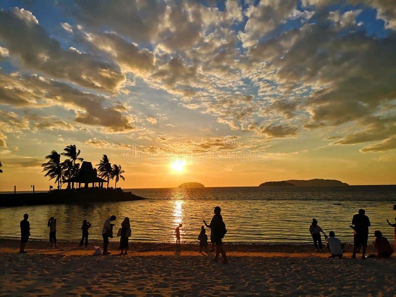Zonsondergang in Strand stock afbeelding