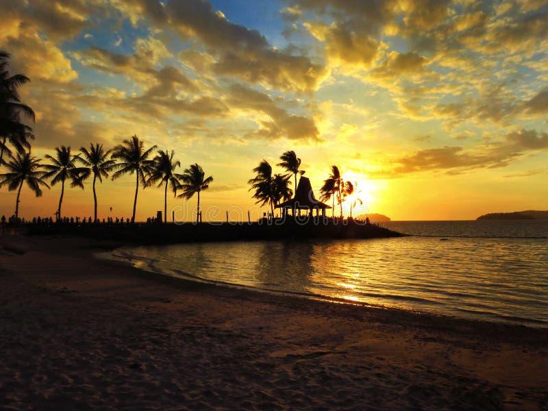 Zonsondergang in Strand stock foto's