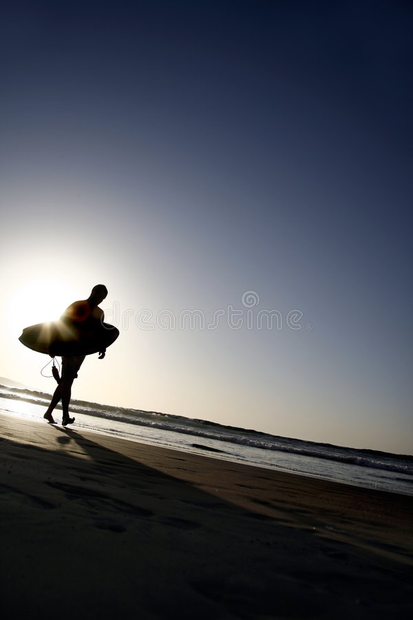 Zonsondergang Surfer stock foto's