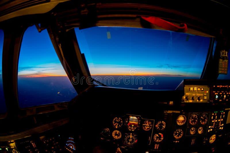 Zonsondergang van de cockpit stock foto