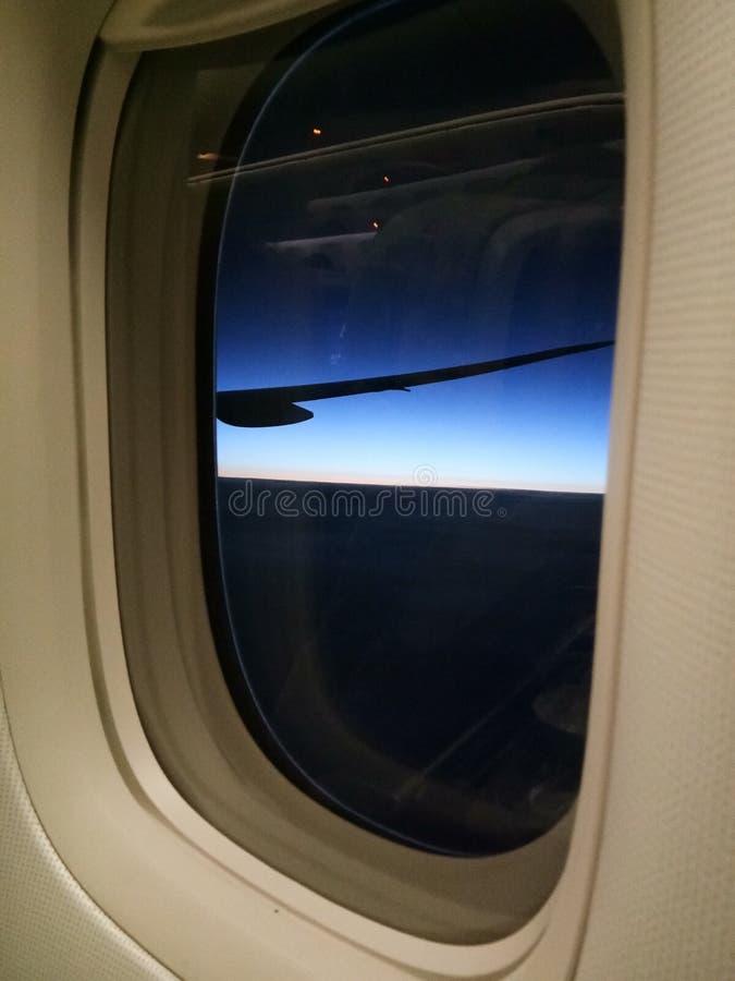 Zonsondergang of Zonsopgangmening in Vliegtuig royalty-vrije stock afbeelding