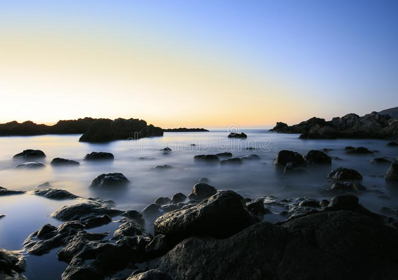 Zonsonderganglandschap in Tenerife Canarische Eilanden Lange Blootstelling royalty-vrije stock foto