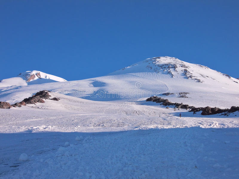 Zonsopgang op de berg Elbrus stock afbeeldingen