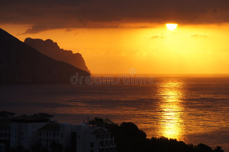 Zonsopgang over Calpe stock foto's