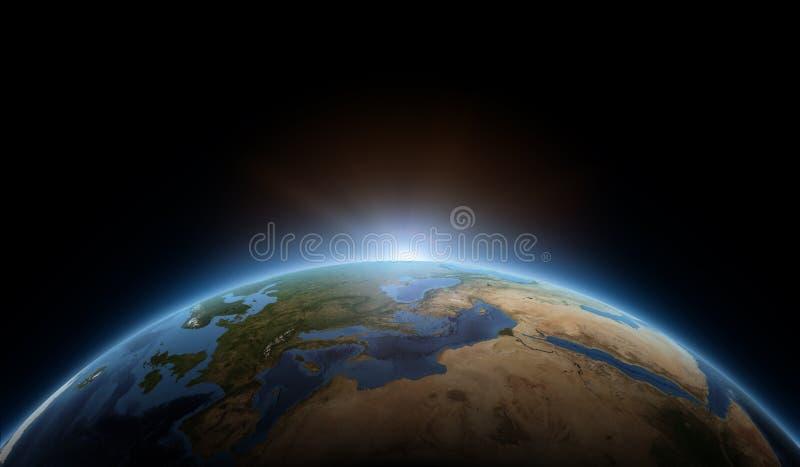 Zonsopgang ter wereld stock fotografie