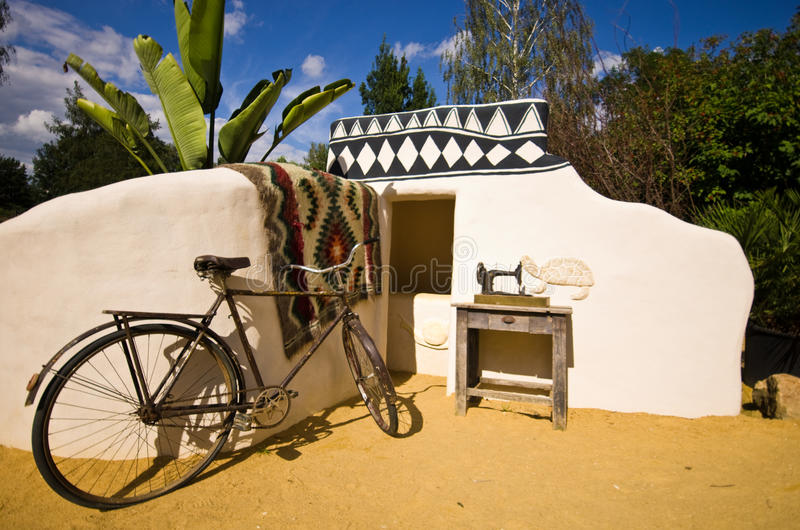 Zoo Safari, Dvur Kralove, Czech Republic. African corner at Zoo Safari, Dvur Kralove, Czech Republic. African hut still life with sewing machine and bicycle royalty free stock photo