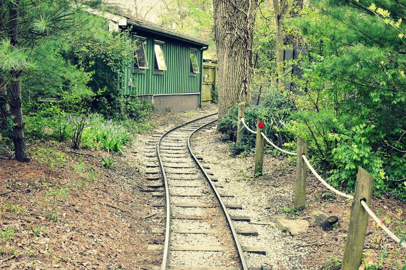 Zoo Train Tracks. Running behind a green building at the Cincinnati Zoo in Ohio stock photo