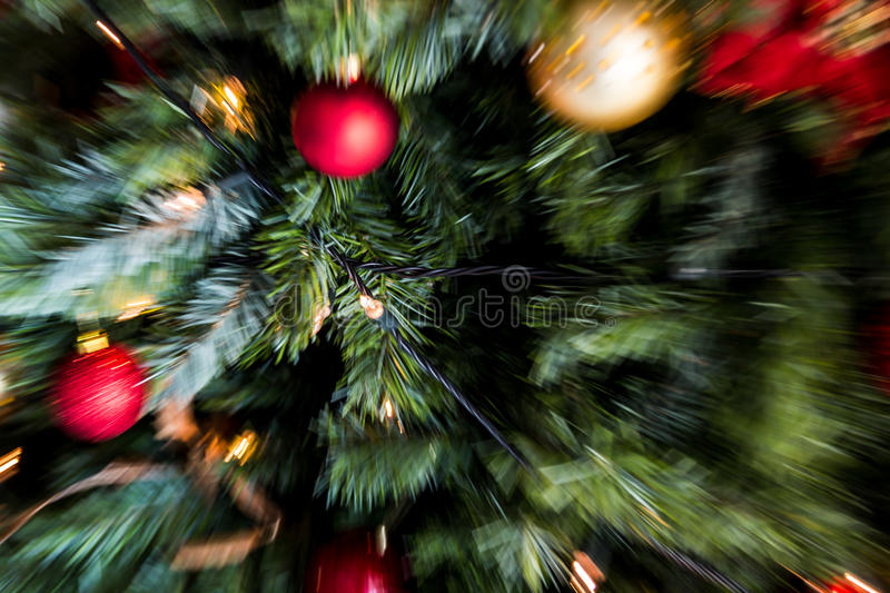 Zoom blast motion blur shot of red and gold christmas decorati stock photo