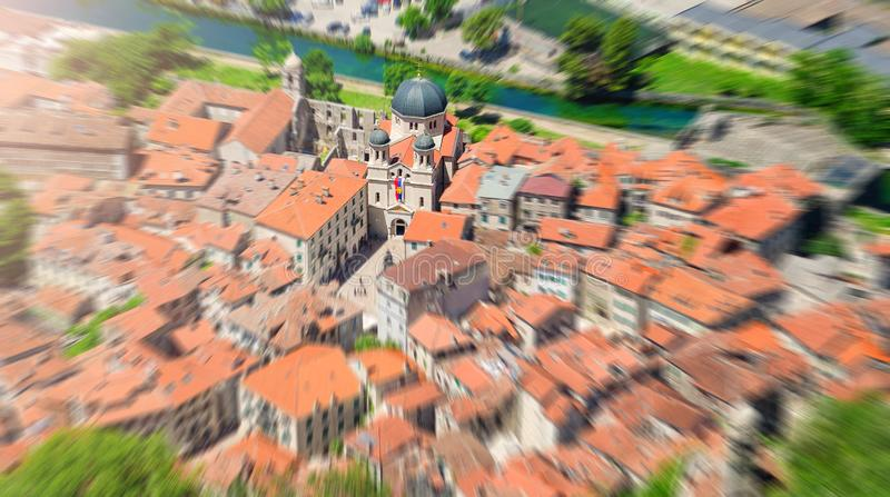 Zoom blurred top view of the old town in Kotor focused on a church. Montenegro stock images