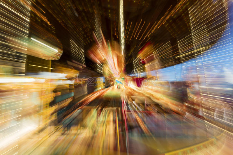 Zoom Burst Photograph of Carousel Merry Go Round Horse. Zoom burst photograph of a fun fair merry go round carousel horse stock photo