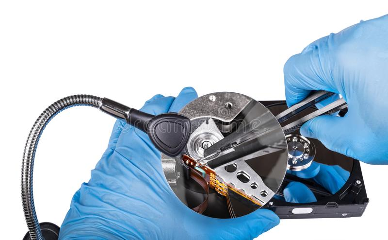 Fix of hard disk drive. Diagnostics close-up. Hands in blue gloves royalty free stock photo
