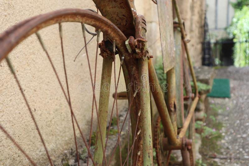 Zoom on old and rusty road bike. Old and rusty road bike vieux velo rouillé france french roue voilée bent wheel stock photography
