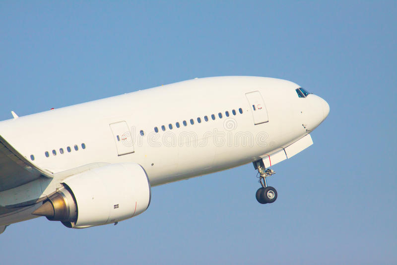 Zoom up front veiw of passenger jet plane take off to flying fro royalty free stock photos