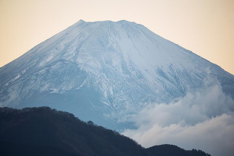 Mount Fuji summit in the clouds. Hakone area of Kanagawa Prefecture in Honshu. Japan. The zoom view of Mount Fuji summit in the clouds from the Hakone area royalty free stock photo
