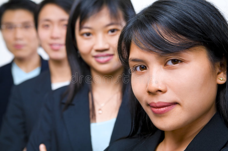 Zoomed portrait of young Asian freshmen lineup. Zoom portrait of Asian young (freshmen)businesspeople lineup stock images