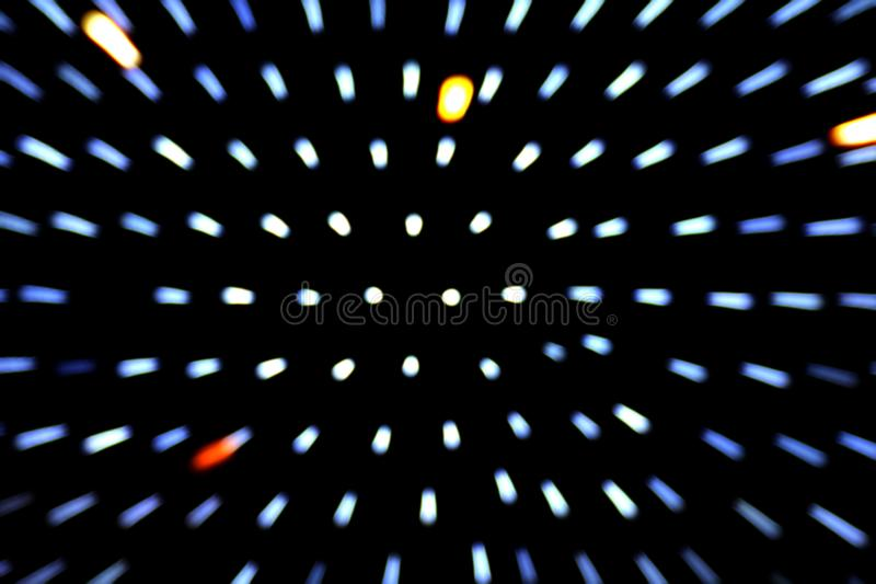 Zoomeffekt bokeh Bewegung beleuchten verwischt auf Hintergrund des dunklen Schwarzen lizenzfreie stockfotografie