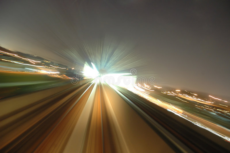 Zooming home. A long shutter zoom effect shot from a train heading towards a station stop