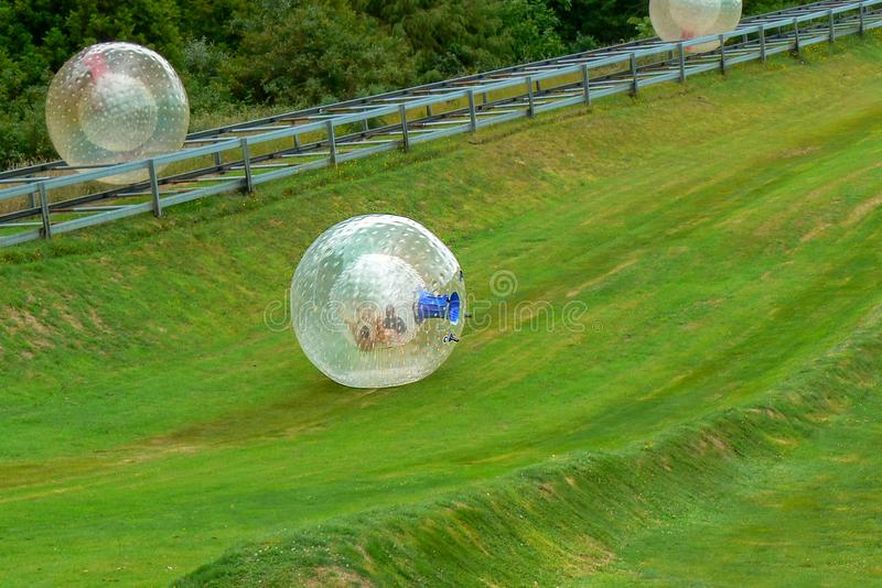The zorb, a fun tourist activity in Rotorua, New Zealand. Zorb is a fun and adventurous tourist attraction. Zorbing consists of rolling downhill in a big plastic royalty free stock image