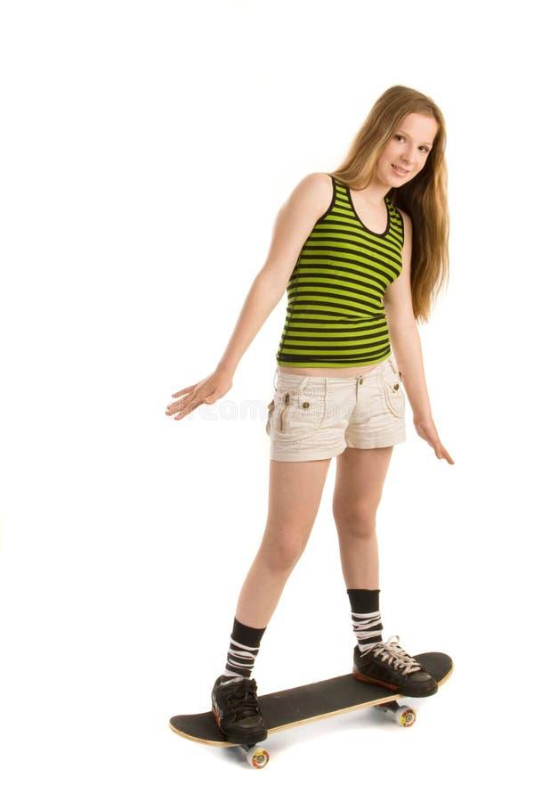 Zorgvuldig meisje op het skateboard royalty-vrije stock foto