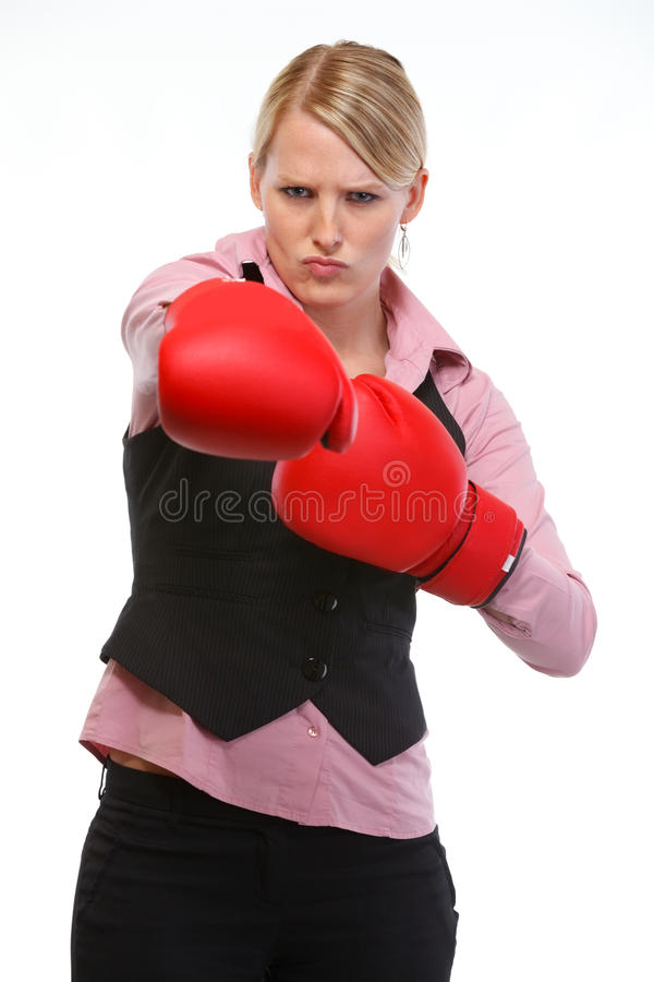 Zornfrauenangestellter beim Verpackenhandschuhlochen stockbild